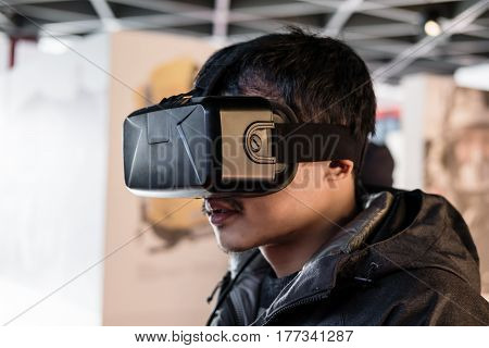 a man wearing VR virtual reality goggles