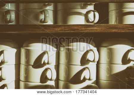 the the stack of coffee cup on the shelf in retro scene