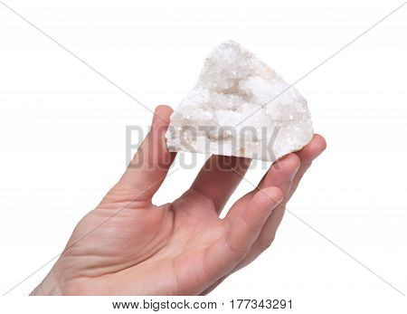 Young woman holding clear crystal quartz geode with crystalline druzy center isolated on white background