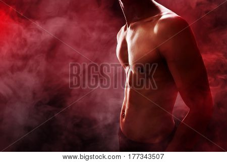 Shape muscular man body with smoke background