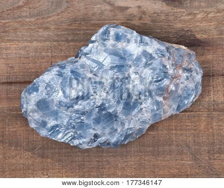 Raw blue white kyanite natural chunk on wooden vintage tray