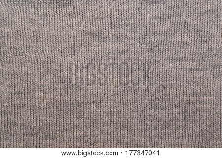 Knitted gray texture. naturel color, warm cloth
