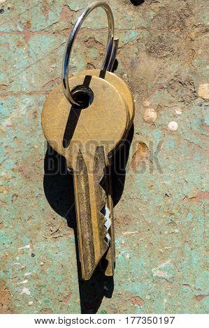 Old keys close-up lying on iron surface