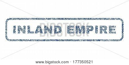 Inland Empire text textile seal stamp watermark. Blue jeans fabric vectorized texture. Vector caption inside rounded rectangular banner. Rubber emblem with fiber textile structure.