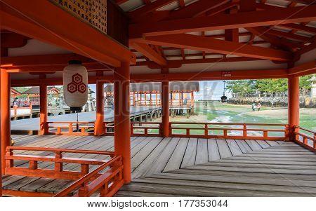 Floating Shrine's hall and pathway of Itsukushima Shrine at low tide in Miyajima island, Japan