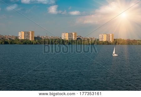 Residential many storeys houses near the river city dnepr, nature background