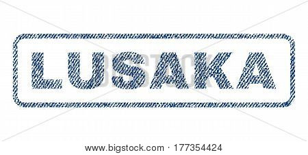 Lusaka text textile seal stamp watermark. Blue jeans fabric vectorized texture. Vector tag inside rounded rectangular banner. Rubber sign with fiber textile structure.