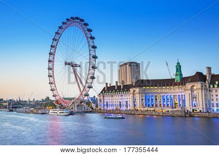 LONDON, ENGLAND - May 14, 2016 : The London Eye near the River Thames at dusk, England. The London Eye is a giant Ferris wheel on the South Bank of the River Thames in the capital of UK.