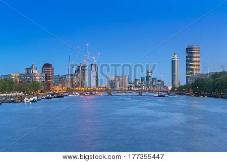 LONDON, ENGLAND - May 14, 2016 : Cityscape of London at night, UK. London is the capital and most populous city of England, Britain, and the United Kingdom.