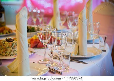 Decorated the table with dishes of food and napkins. Ceremonial lavish Banquet. Luxurious decoration of the holiday feast with a serving.