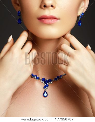 Elegant Fashionable Woman With Jewelry. Beautiful Woman With A Sapphire Necklace. Beauty Young Model