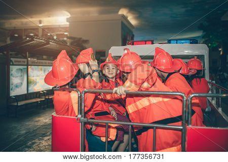 Children Having Fun In .indoors Playground As The Fireman