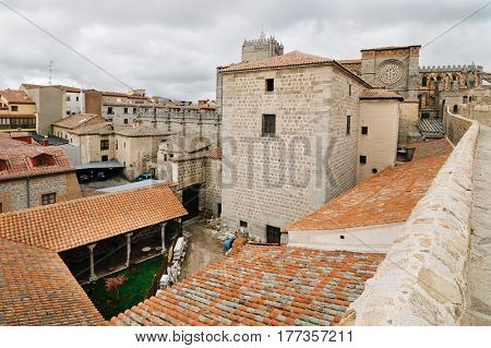 Avila Spain - November 11 2014: The Medieval Walls of Avila and the cathedral. Cloudy day. The old city and its extramural churches were declared a World Heritage site by UNESCO