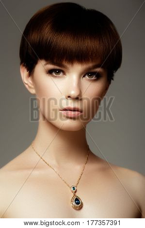 The Beautiful Woman In Expensive Pendant Closeup. Fashionable Jewelry Set, Ring And Earrings