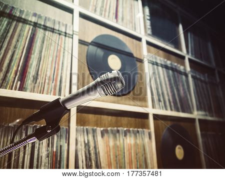 Microphone with Vinyl Records Shelf on background