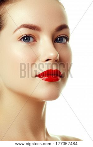 Beautiful Woman's Purity Face With Bright Red Lip Makeup