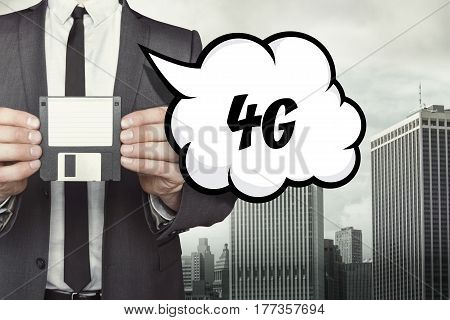 4G text on speech bubble with businessman holding diskette
