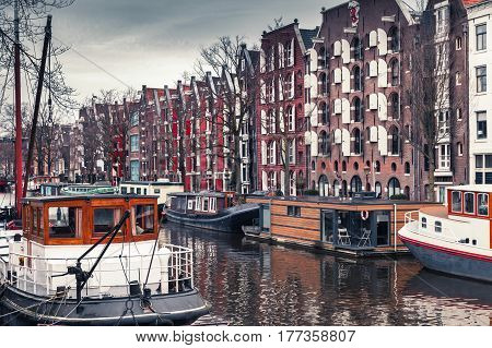 Houseboats Along The Canal In Amsterdam
