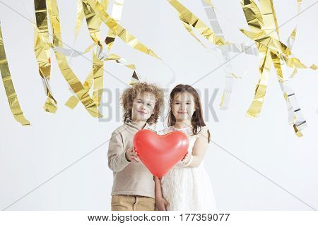 Little Couple Holding Red Heart
