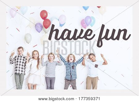 Kids Standing With Balloons In A Room