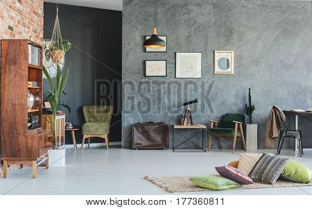 Old-school living room interior design with grey walls and wooden furniture