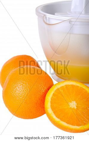 Still life with a juice extractor isolated on white