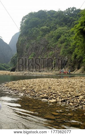 A bamboo raft ride on the nine bend river (Jiuqu Xi) in the wuyishan scenic area in Fujian province China.