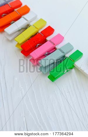 Heap of colorful pin on white wooden tabletop