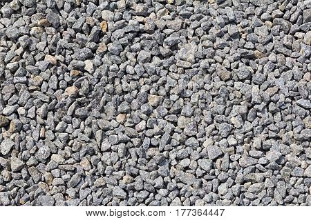 Granite gravel of macadam, Rock gray crushed for construction on the ground, Scree texture background