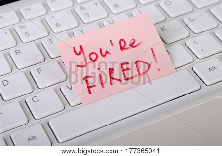 Job dismissal notice is on computer keyboard