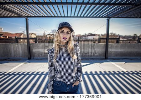 Portrait Of Fashion Woman Wearing Checkered Shirt And Leather Cap-2