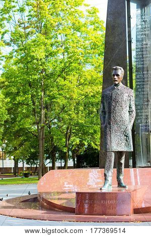 Vilnius Lithuania - August 8 2012: Bronze monument to Vincas Kudirka on granite pedestal in eponymous Park. Vincas Kudirka - national hero of Lithuania author of words and music of National Anthem