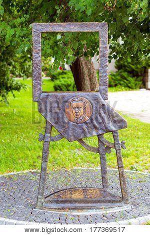Vilnius Lithuania - August 8 2012: Bronze monument to Mstislav Valerianovich Dobuzhinsky in Cathedral Square. Dobuzhinsky 1875-1957 - Russian artist master of urban landscape art critic memoirist
