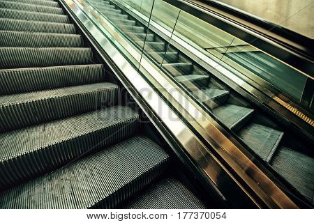 Empty moving escalator in underground railway station modern urban city life background