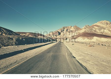 Retro Toned Picture Of A Desert Road In Death Valley, Usa.