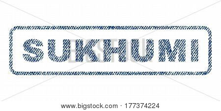 Sukhumi text textile seal stamp watermark. Blue jeans fabric vectorized texture. Vector tag inside rounded rectangular banner. Rubber sign with fiber textile structure.