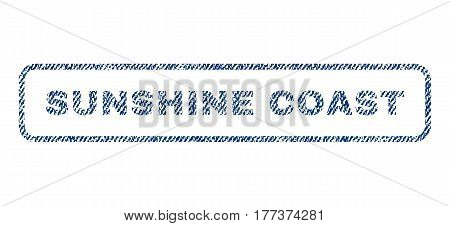 Sunshine Coast text textile seal stamp watermark. Blue jeans fabric vectorized texture. Vector caption inside rounded rectangular shape. Rubber emblem with fiber textile structure.