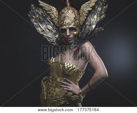 Twilight, Latin woman with green hair and gold tiara, wears a handmade warrior armor