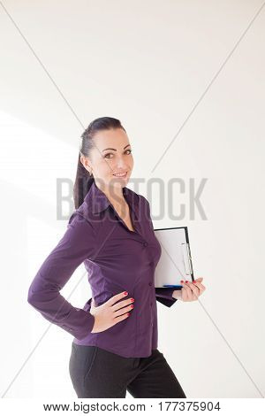 business girl stands with a folder with the documents