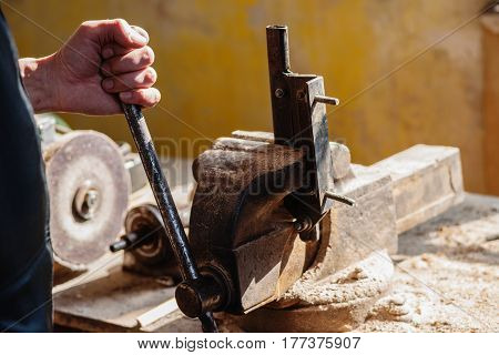 Photography of a man working with metal vise