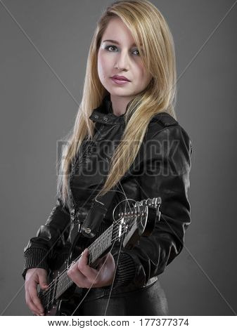 Model Rockstar, rocker woman with black leather outfit, lovely blonde with long shiny hair