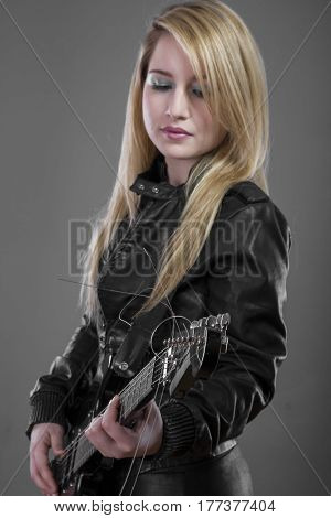 Performer Rockstar, rocker woman with black leather outfit, lovely blonde with long shiny hair