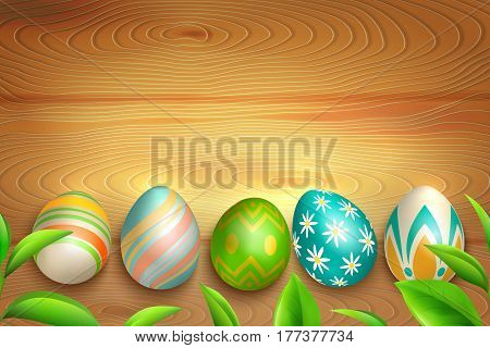 Colorful easter eggs with floral and striped ornaments and green leaves on light wooden background vector illustration