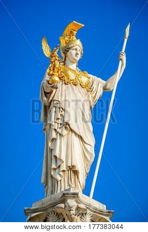 Vienna Austria. Austrian Parliament with the statue of Athena of the greek goddess of wisdom. Wien.