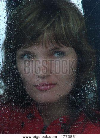 Girl Looks Thru Waterdropped Widow Glass 001