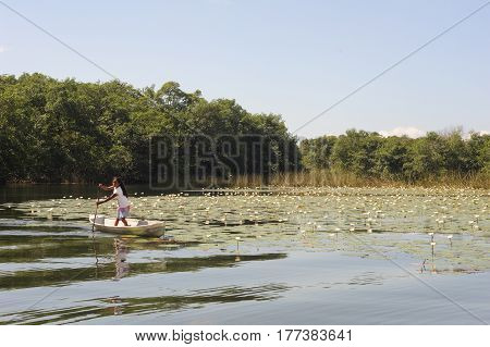 Girl On Canoe At Isla De Las Flores On River Dulce