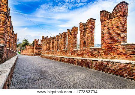Verona Italy. Detail of medieval stone bridge of Ponte Scaligero over Adige River built in 14th century near Castelvecchio.