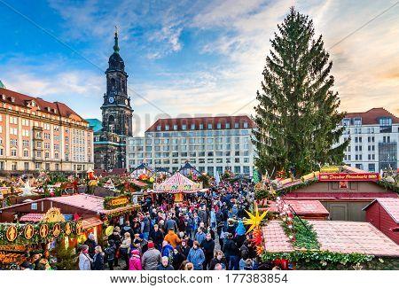 DRESDEN SAXONY / GERMANY - 17 DECEMBER 2016: People visit Christmas Market Striezelmarkt in Dresden Germany. Christmas fair European traditions.