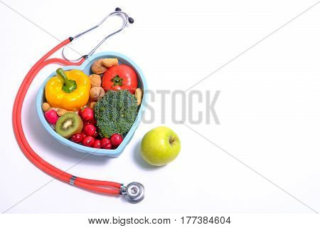 Heart Shaped Dish With Vegetables And Stethoscope