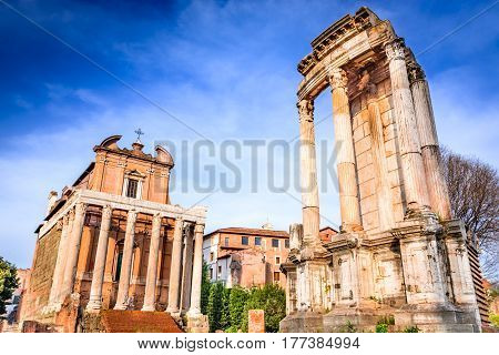 Rome Italy. Ancient ruins of Roman Forum with Temple of Antoninus Pius and Faustina ancient Roma city center heart of empire.